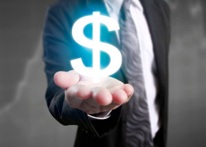 man in business suit holding dollar sign in hand