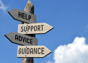 Sign With Help Support Advice And Guidance Written on them
